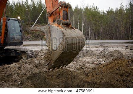 Excavator With A Raised Bucket