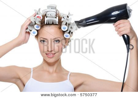 Woman With Hair-curles And Hairdryer Doing Hairstyle