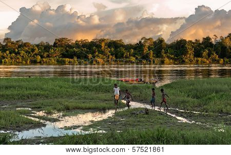 Children Play On The River Bank