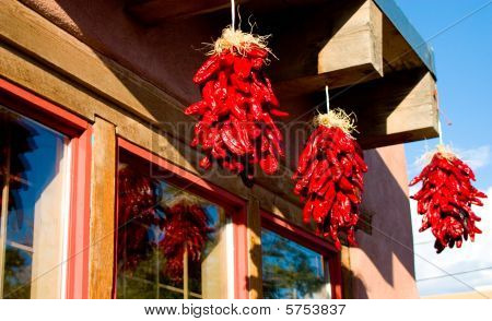 Hanging ristras reflected in window