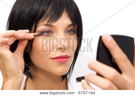 Beautiful Woman Checking Her Makeup