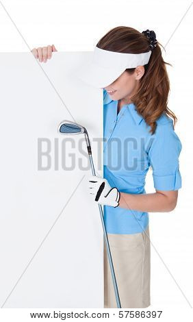 Female Golfer With Blank Board