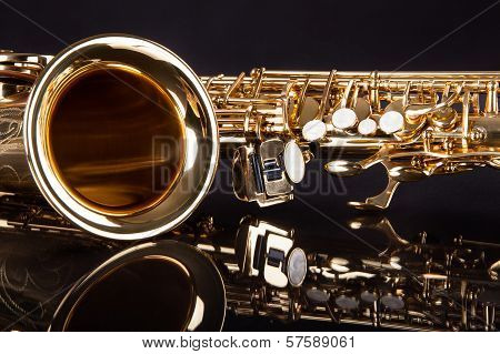 Close-up Of Trumpet Over Black Reflective Background poster