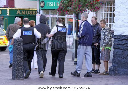 British police arresting a criminal, Brixham, Devon, 29/8/09