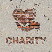 Charity Word and Icon of Heart in the Hand on the Brick Wall. poster