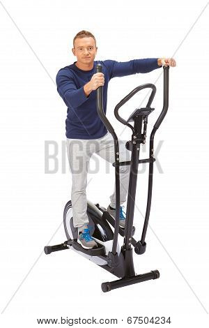Man Uses Elliptical Cross Trainer.