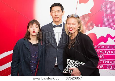 MOSCOW - JUNE, 28: Russian actor E. Sangadzhiev (White Yagel movie) with friends. 36st Moscow International Film Festival. Closing Ceremony at Rossiya Cinema . June 28, 2014 in Moscow, Russia