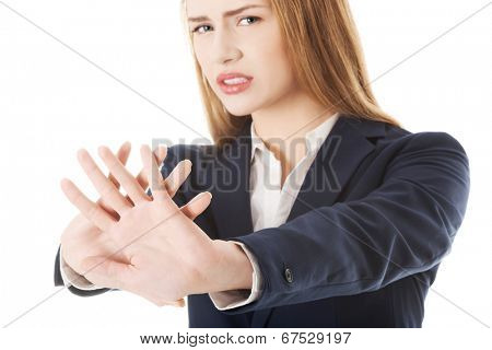 Business woman showing stop gesture.