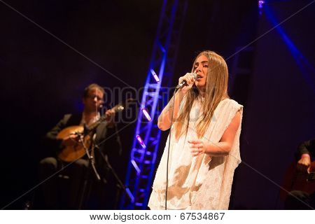 LOULE - JUNE 28: Gisela Joao a portuguese fado singer performs on stage at festival med, a world music festival in Loule, Portugal, June 28, 2014