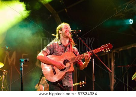 LOULE - JUNE 27: Jahcoustix a reggae musician from Germany performs on stage at festival med, a world music festival in Loule, Portugal, June 27, 2014
