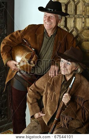 Happy gunslingers in western garment