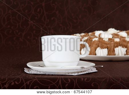 Gateau, cup, saucer and spoon