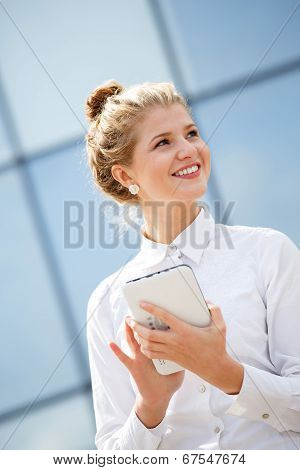 Businesswoman Using Tablet Computer In The City
