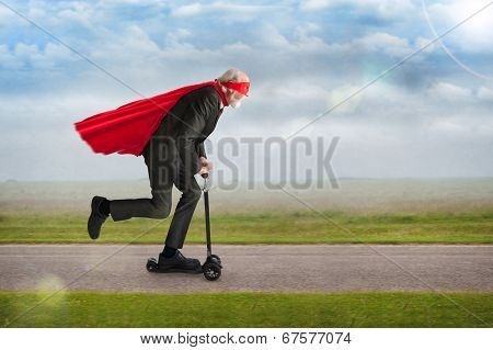 Senior Superhero Riding A Scooter