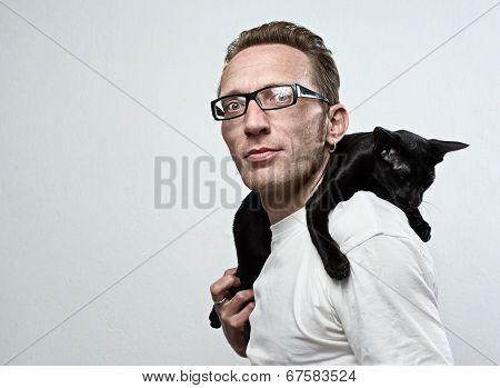 smiling man with a sad cat on his shoulders. animal care concept. poster