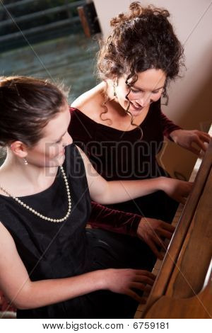 Mother And Daughter Playing Piano