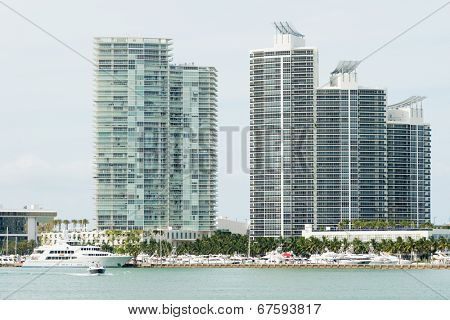 MIAMI,USA - MAY 27,2014 : Modern residencial buildings on Miami Beach with modern yachts docked nearby
