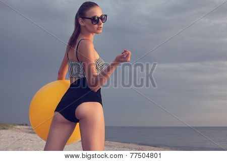 Sexy Styled Girl With Ball Posing On The Beach