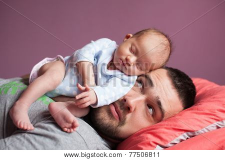 Newborn Baby Sleeping With Father
