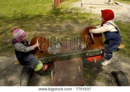 Children on seesaw