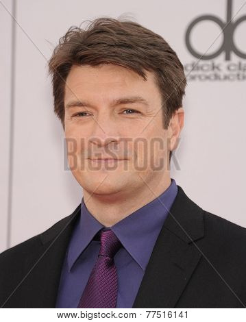 LOS ANGELES - NOV 23:  Nathan Fillion arrives to the 2014 American Music Awards on November 23, 2014 in Los Angeles, CA