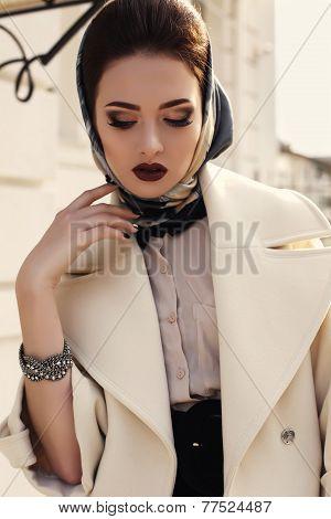 Beautiful Girl In Elegant Beige Coat And Silk Scarf On Head