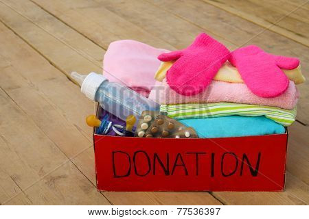 Donation box for children: things, tablets and personal items poster