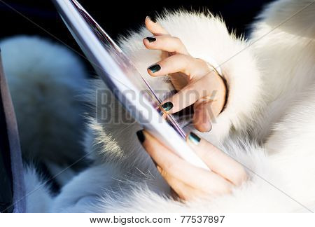 Woman In White Coat With laptop Laughing