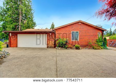 Log Cabin Style House Exterior With Garage.
