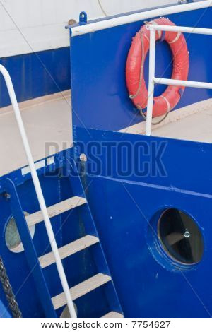 Blue boat with orange lifebuoy - landscape poster