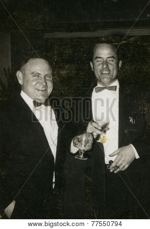 CANADA - CIRCA 1940s: An antique photo shows portrait of a two businessmen.