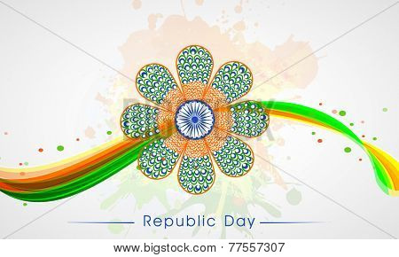 Peacock feathers decorated flower design with Ashoka Wheel and national flag colors on splash background.