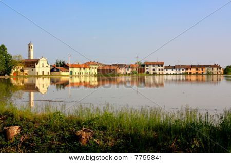 Village Reflecting In A Ricefield Italy