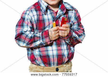 Little boy holding a firecrackers. Selective focus