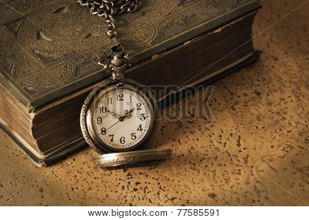 An antique pocketwatch and book come together to remember the wisdom of the old days. An antique technique was used and contains added noise for realistic effects. poster