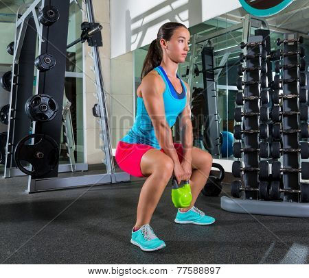 goblet kettlebell squat woman workout exercise at gym