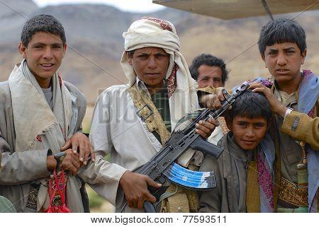 Yemeni teenagers pose with Kalashnikov machine gun, Hadramaut valley, Yemen.