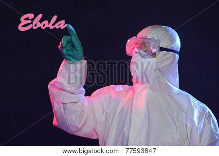 Scientist in protective hazmat suit writing the word Ebola