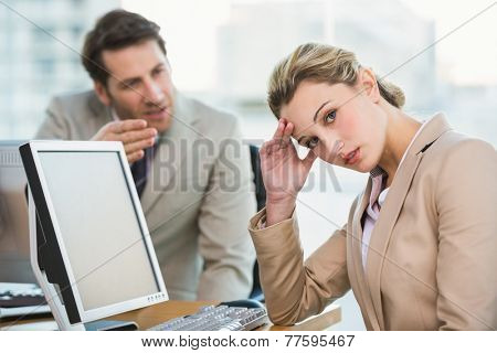 Businessman arguing with a colleague at work