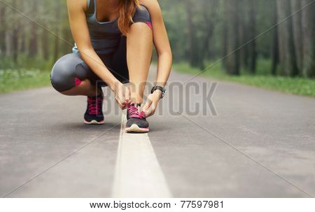 Young Sporty Woman Preparing To Run In Early Foggy Morning In The Beautiful Nature Forest