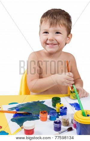 Little Boy Drawing With A Brush