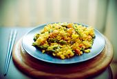Spanish Paella With Seafood In A Blue Dish