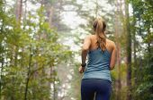 healthy lifestyle fitness sporty woman running early in the morning in forest area fitness healthy lifestyle concept poster