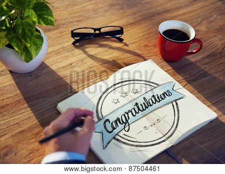 Man with Note Pad and Congratulations Concept