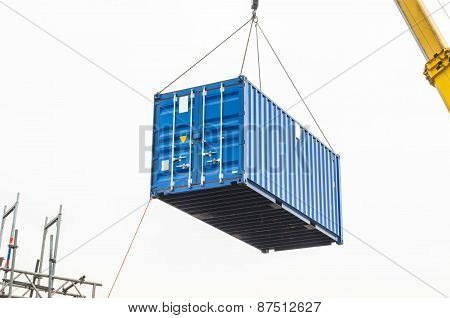 Blue building containers cargo containers residential containers at a loading crane. poster