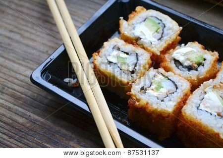 Delicious rolls and sushi with shrimp, cucumber and philadelphia