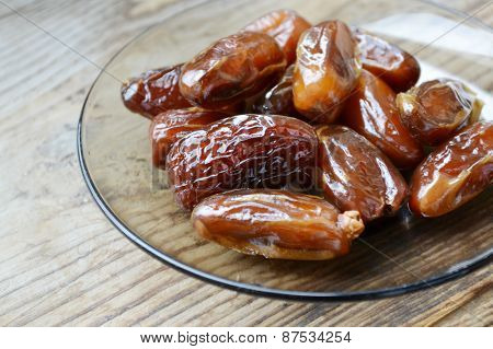 Brown dates fruit on wooden table