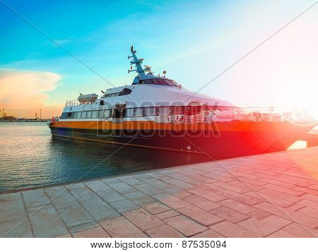 Ship At The Port In The Setting Sun