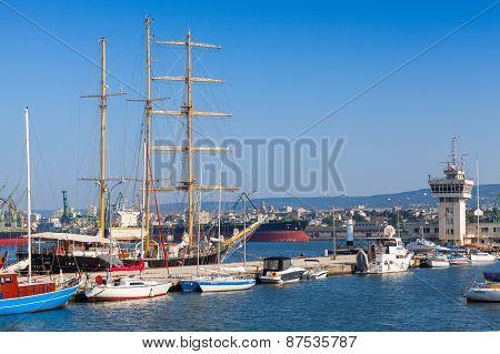Big Sailing Ship And Pleasure Boats In Port Of Varna