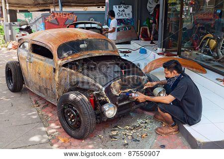 Balinese Man Renews Old Car